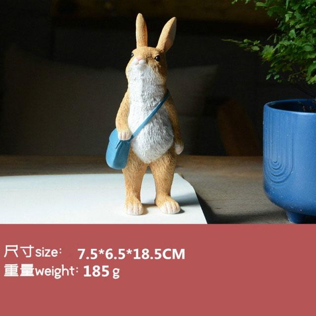 """<span class=""""title"""">ウサギ置物、ウサギ人形、水色のショルダーバッグを持って見つめるうさぎ、兎のフィギア、ウサギオブジェecqdrabbit026</span>"""